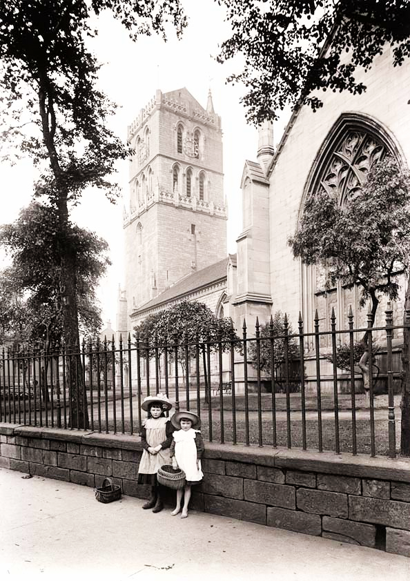 Two Small Girls in front of Old Steeple